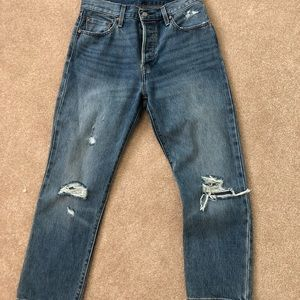 Dark wash ripped Levi's 501 jeans